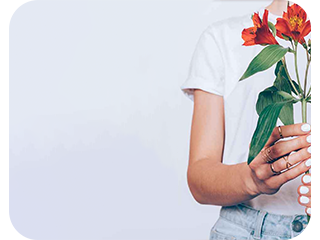 girl on a white background holding flowers in her hands