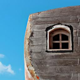 shipyard veryoldboat abandoned window blueskyandclouds