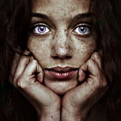 beautiful freckle violet eyed girl