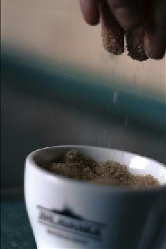 cup sugar hand macro blue freetoedit