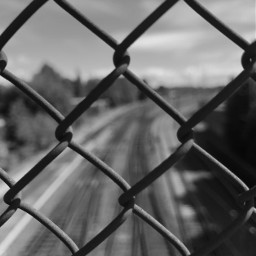 blackandwhite railway fence riga latvia