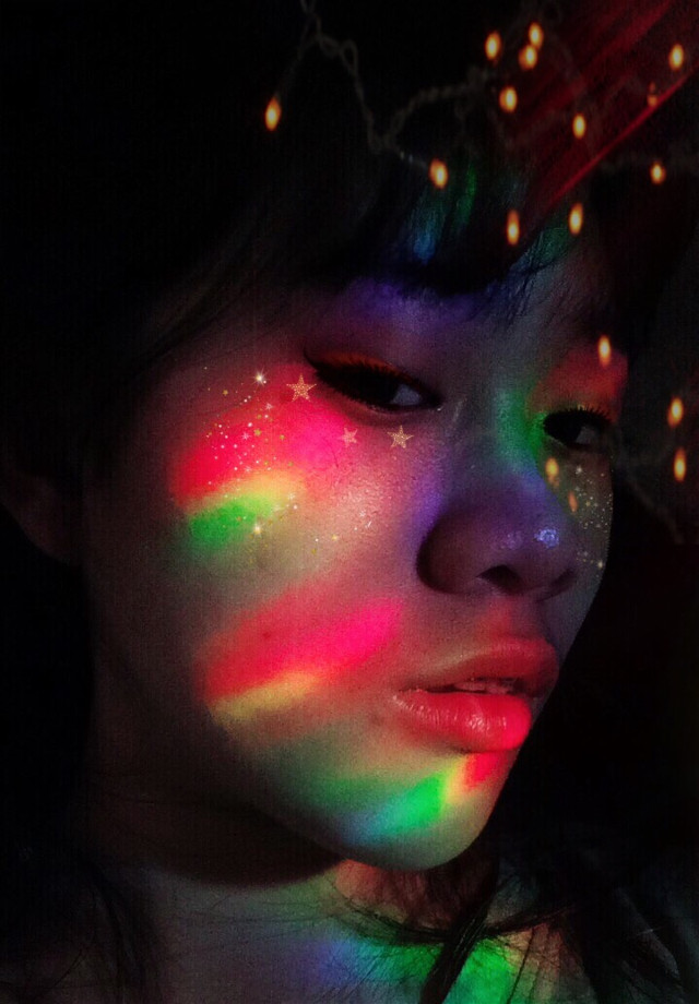 A splash of rainbow lights on a blank canvas that is my face.🌈 (P.S. The rainbow lights are real. Everything else are edited.)  #freetoedit #interesting #art #photography #rainbowlight #rainbow #lights #makeup #face #remixme #remixit #remix #mask