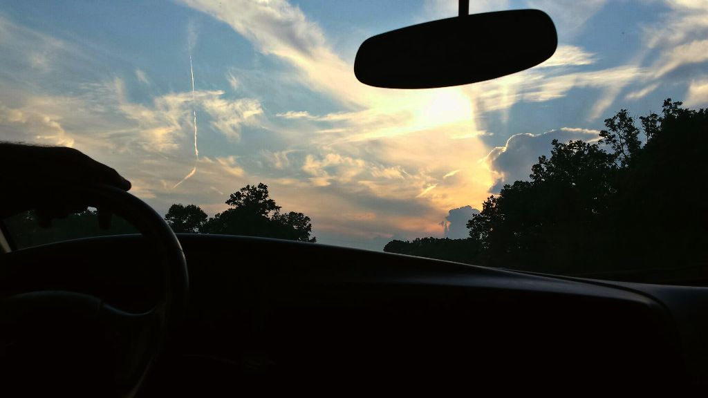 I learned that I drive a little too fast sometimes #freetoedit #remixit #photography #sunset #window #travel #trees #car #steeringwheel #mirror #road #sky