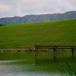 pier wooden green hills reflection scenicview freetoedit