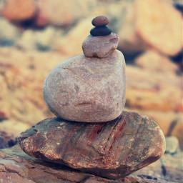 nature goldenhour rockybeach stackingstones beautifullight