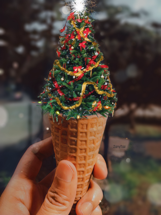 """Christmas delight!! 🎄🌟✨🌿☺️ #holiday #christmas #pine #tree #christmasspirit #christmastree #cone #hand #filters #blur 🦌🎅🎄🌟#myedit #madewithpicsart #be_creative #freetoedit ❤️🌿☺️ Wow! Thank you @picsart and Thank youuuuuu ALL for so much love! Xoxo  👉This edit was so easy to do. Here's the STEPS I took.  1. Below the edit you can see the """"sources"""" I used. You can use the ice cream cone pic that I used or find a new pic of an original ice cream cone if you want to do something different?  2.Then go to #stickers and search for """"Christmas tree"""". Look for a sticker that will have an angle that will fit on the cone naturally.  3. Once you found the Christmas tree sticker, place the 🌲 on top of the ice cream part on the photo. 4. If the tree doesn't have a 🌟 then you search for that as well. In my case I used a sparkle from the magicbrushes section. I thought that worked better. 5. Then for the finishing touches I went to the #magicbrushes and I used faded circles. And I also used a filter in #fx to blend image together (don't remember which one, but you can experiment on that) and there you have it. 👉 You got yourself a  Christmas Cone 😁🎄🍦❄️ Try it."""