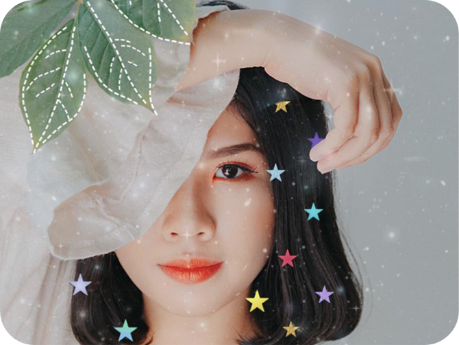girl with green leaf and colorful star stickers