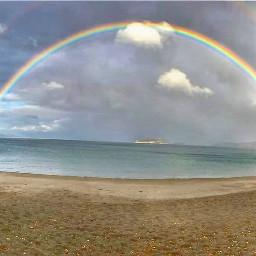 beach rainbows see