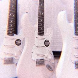 white electricguitar black peachishwhite