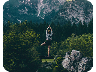a yoga girl in an amazing nature