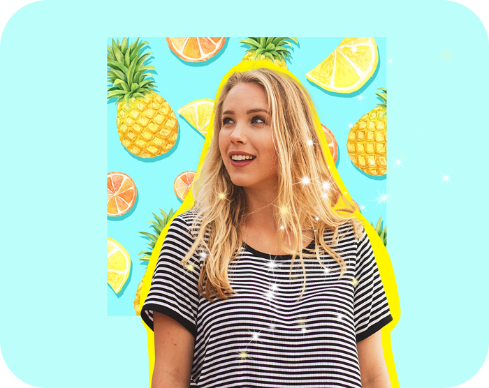 blond hair girl looking left and posing on a blue background of juicy pineapple and lemon stickers