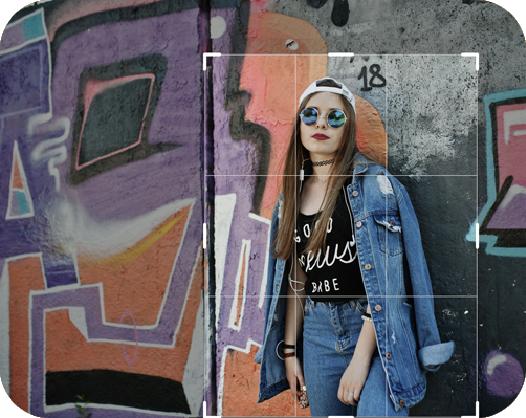 girl in denim and cap posing at the grafite