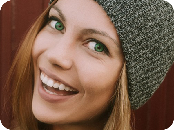 blond hair green eyed girl smiling